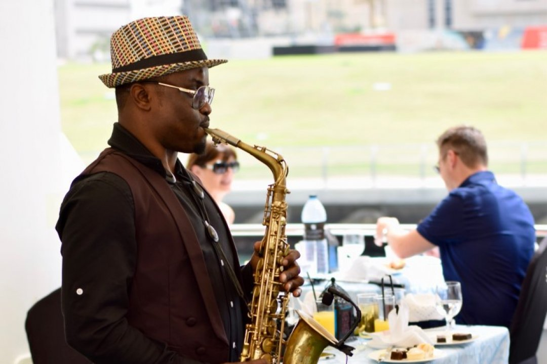 High Tea saxophonist